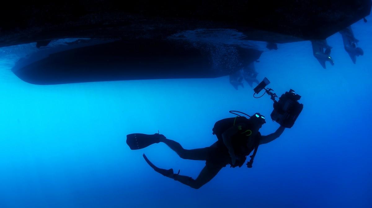 scuba diver in deep blue sea